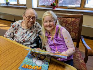 2nd grader pictured with resident