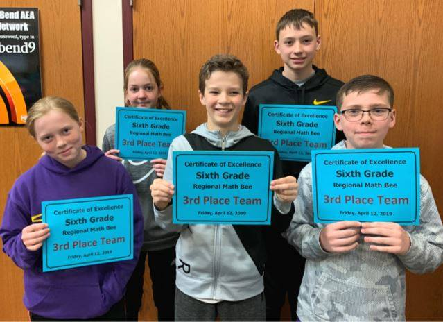6th graders holding certificates receiving 3rd place at regional math bee
