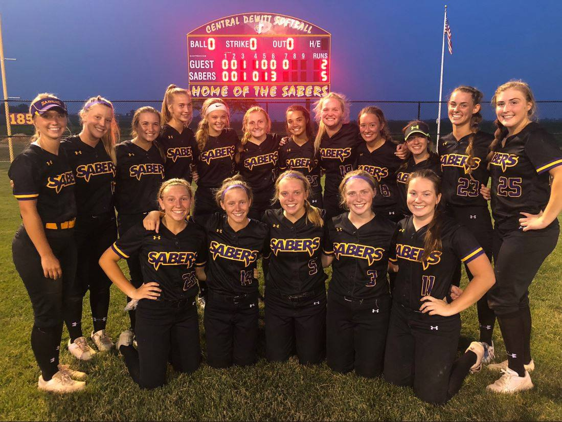Saber Softball Team standing in field after win